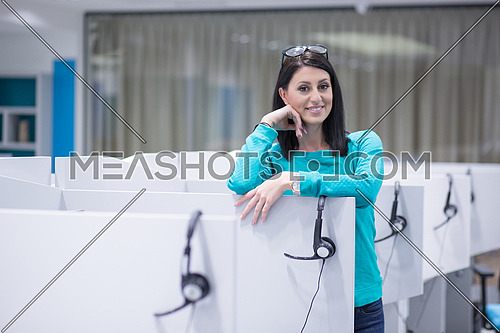 young smiling female call centre operator doing her job with a headset