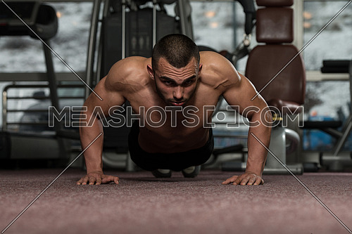 Young Adult Athlete Doing Push Ups As Part Of Bodybuilding Training