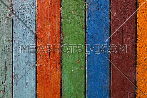 Multicolor old vintage grunge dirty painted colorful wooden planks background texture close up