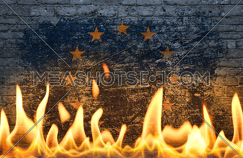 Close up wall with painted European Union EU flag in flames as symbol of world on fire, danger, political, economic crisis or pandemic