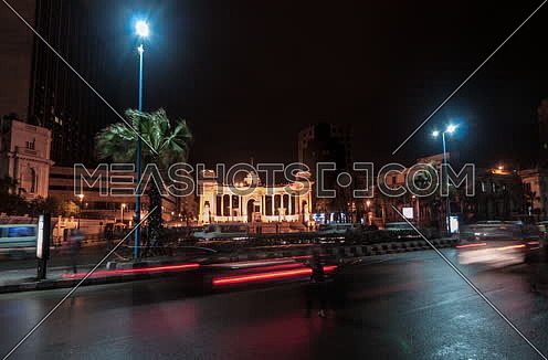 Track Left long shot for traffic towards Alexandria Naval Unknown Soldier Memorial at night