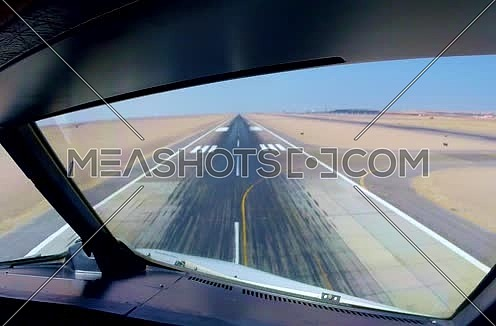 Cockpit view for a air plane landing at Egypt Hurghada Airport