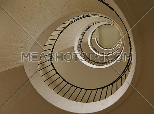 Spiral staircase with curve shape diminishing perspective, low angle view