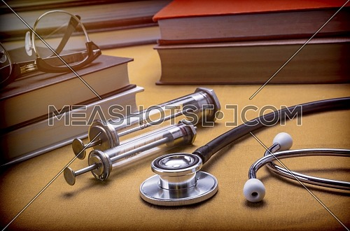 Medicine Books Next To Syringes Vintage And Stethoscope, Concept Of Medicine