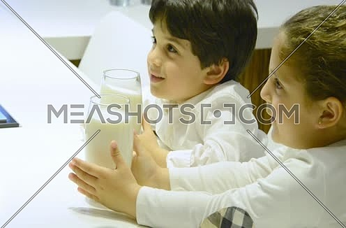 Close up for two kids drinking milk