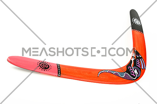 One wooden painted original colorful souvenir boomerang over white background