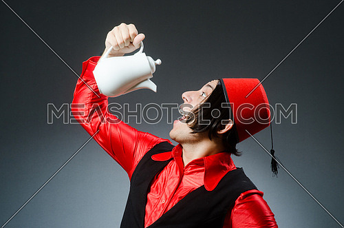 Man wearing red fez hat