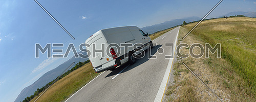 delivery cargo van for small business transportation driving fast on road