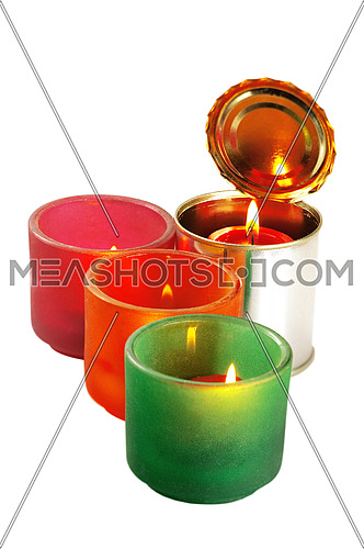 red candle on a tin can ovr white background