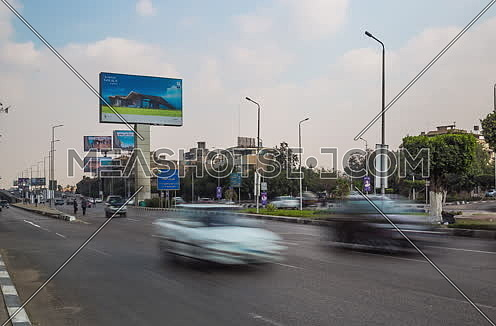 Zoom Out Shot for traffic at Salah Salim Street showing AL Galaa Bridge in background at Daytime
