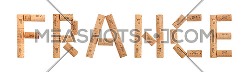 Word FRANCE shaped by natural wooden red wine bottle corks of different vintage years isolated on white background