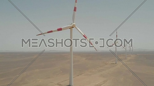Drone shot of windmills by the red sea coast