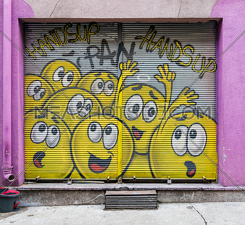 Istanbul, Turkey - April 18, 2017:  Closed shop exterior with metal door covered with colorful graffiti at Karakoy district, Istanbul, Turkey