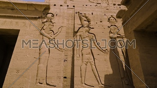 Track into Writings on the wall of Temple of Phila at Aswan - Egypt by day