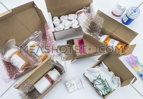 unpacking medication in boxes, Diverse medicines in boxes for humanitarian aid, conceptual image