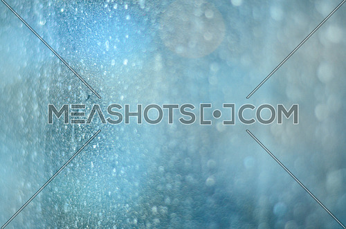 a close up photo of dust drops on a glass