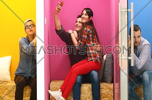 Colorful startup office with business people having fun