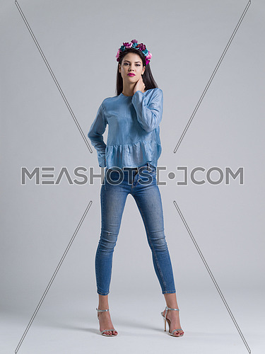 Fashion Model girl isolated over white background. Beauty stylish woman posing in fashionable clothes  Casual style with beauty accessories. High fashion urban style