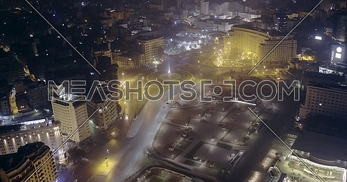 Drone shot fly away from Tahrir Square showing National Flag Pole in Cairo at night