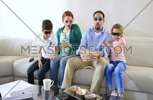 middle eastern family watching 3d content at home livingroom