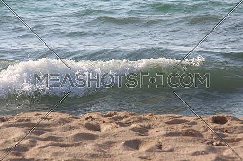 A photo of a wave in the mediterranean sea on the shore of Alexandria Egypt