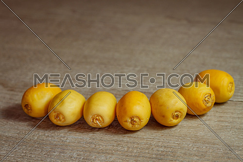 Yellow dates arranged as a wide smile
