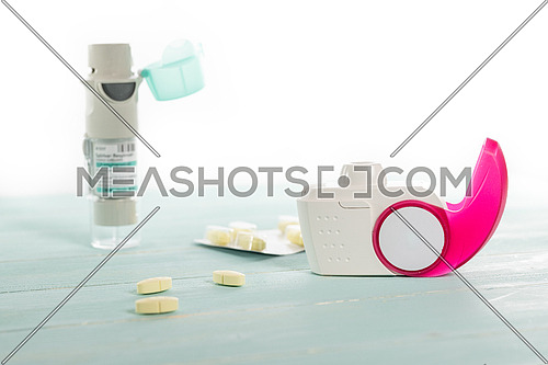 Set of asthma inhaler, anti-allergy pills and aerosol machine with inhaler mask,concept asthma and treatment on white background,copy space.