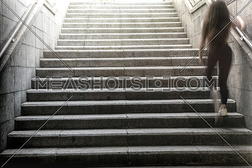 Girl going up stairs to the bright exterior