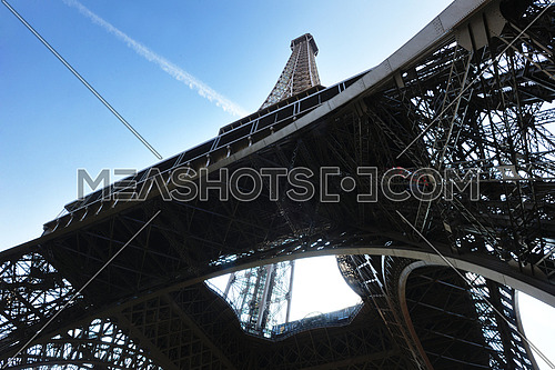 Eiffel Tower in Paris against a dramatic blue sky at day tourist and travel attraction
