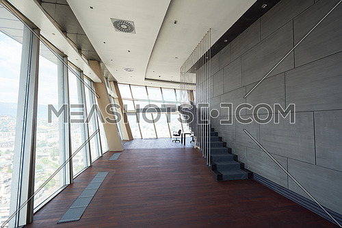 modern bright empty office or living room  interior with big windows and stairs
