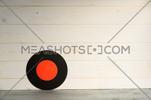 Vinyl record on wooden background,Old vintage vinyl record isolated