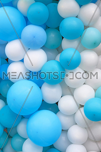 Close up festive background of blue and white air balloons of different sizes