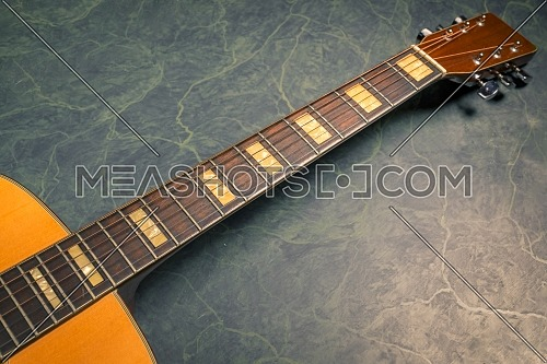 acoustic guitar on green marble background,music concept.