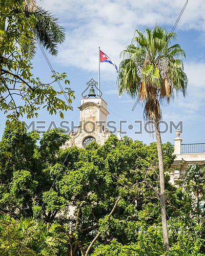 In the picture the Cuban flag placed on a bell tower in the center of Havana