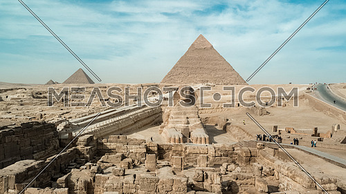 Extreme High angle aerial long shot for the Sphinx and The Great Pyramids of Giza in the background