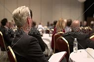 Medium shot for a businessman attending a business conference.