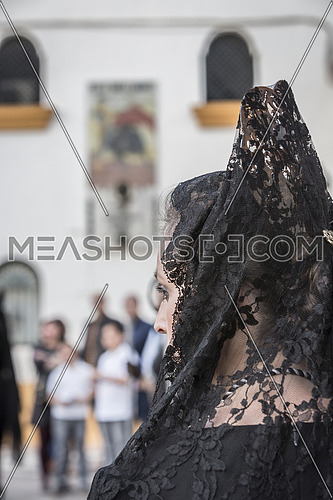 Linares, SPAIN - April 12: Women dressed in typical suit of Spanish mantilla, to fund the bullring of Linares and poster of the anniversary of the death of Manolete during Holy Week, Linares, Andalucia, Spain