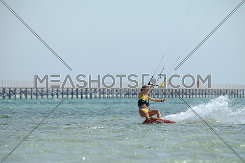 Female Kite Surfer while surfing in Red Sea at day.