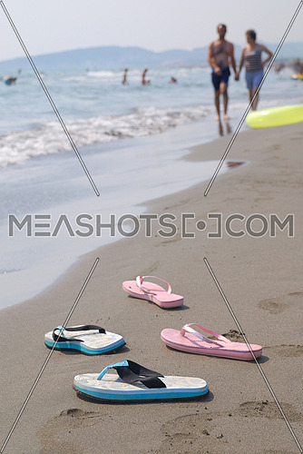 Pair of Sandals on the beach