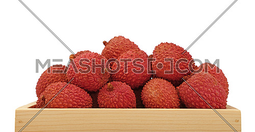 Heap of fresh picked red ripe litchee (Litchi chinensis) tropical fruits in wooden container box isolated on white background, close up, low angle side view