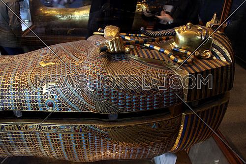 a photo from inside the Egyptian museum in Cairo showing a display for some of King TUTANKHAMEN treasures (cover for mummy)