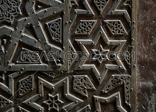 Ornaments of the bronze-plate door of Sultan Qalawun mosque, an ancient historic mosque in Old Cairo, Egypt