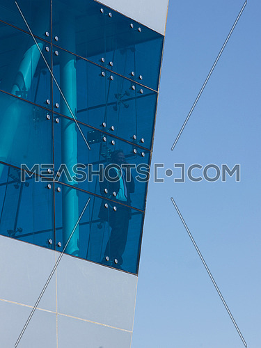senior business man  on window  at modern office building outdoor shoot with blue sky in background