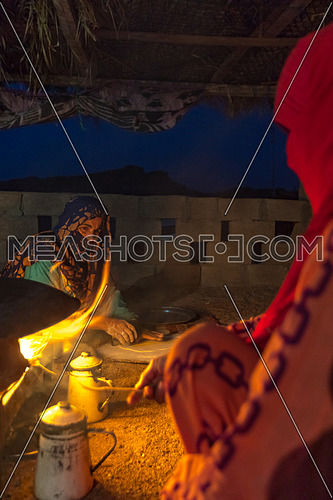 Bedouin Females cooking traditional food at a shelter in Sainai at Night