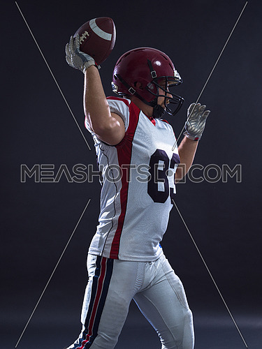 one quarterback american football player throwing ball isolated on gray background