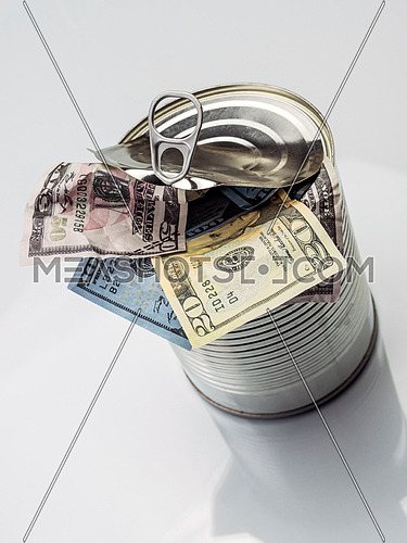 Canned cans full of dollar bills, conceptual image isolated on white background