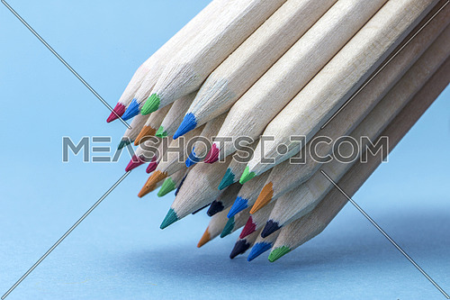 Texture of colored pencils isolated on blue backgtound