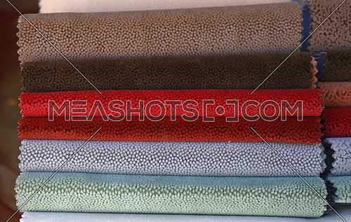 Close up swatch of assorted colorful upholstery textile fabric for decoration