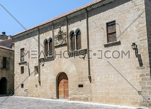 Caceres, Spain - july 13, 2018:  Caceres, Spain: Palacio de Mayoralgo, located in Plaza de Santa Maria is from the late 15th and early 16th century, in the central part has a great Renaissance coat of Mayoralgo, Caceres, Spain
