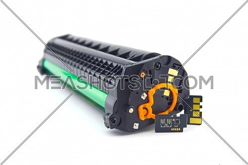 Laser printer toner cartridge and reset chip isolated on white background